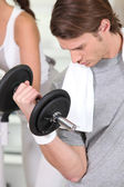 Man lifting a dumbbell — Stock Photo