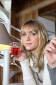 Woman drinking a glass of wine — Stock Photo