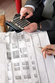 Architects making calculations — Stock Photo