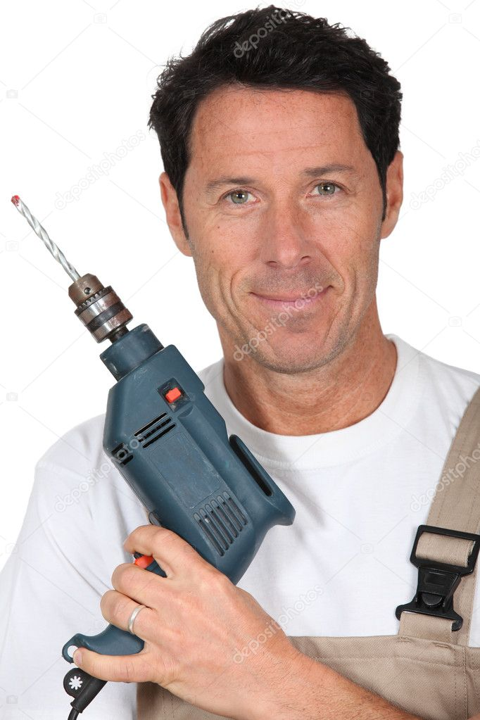 Closeup smiling man with power drill — Stock Photo #11030696