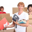 Three housemates moving out - Stock Photo