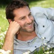 Man lying on grass — Stock Photo #11040584