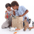 Kids playing with toys — Stock Photo