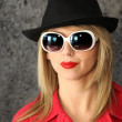 Stock Photo: Womwith sunglasses and hat