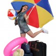 Young woman excited to go on vacation - Stock Photo