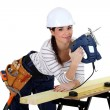 Female woodworker smiling — Stock Photo #11043036