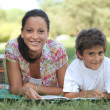 Mother and son enjoying a picnic — Stock Photo