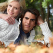 Couple lying in the park — Stock Photo