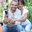 Stock Photo: Couple with fishing rod