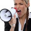 Young screaming in megaphone - Stock Photo