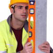 Stock Photo: Craftsmusing ruler