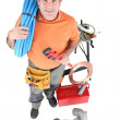 Stock Photo: Plumber with tools of trade