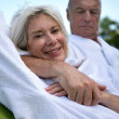 Elderly couple cuddling — Stock Photo
