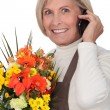 Royalty-Free Stock Photo: Mature florist holding bouquet