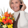 Stock Photo: Mature florist holding bouquet