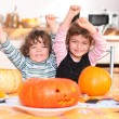 Happy children with carved pumpkins — Stock Photo