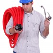 Plumber with piggy bank — Stock Photo #11047553