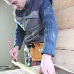 Carpenter marking of piece of wood — Stock Photo