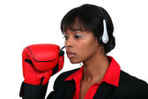 Woman with audio helmet and boxing gloves — Stock Photo