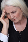 Grandmother grieving — Stock Photo