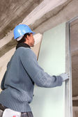 Man installing plaster board panel — Stock Photo
