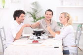 Fondue with friends — Stock Photo