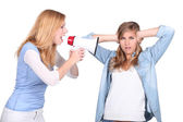 Girls screaming in a bullhorn and girl covering her ears — Stock Photo