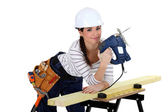 Female woodworker smiling — Stock Photo