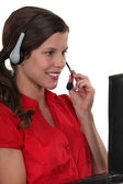 Woman with a laptop and headset — Stock Photo