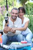 Couple with fishing rod — Stock Photo