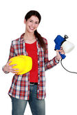 Decorator with a paint gun — Stock Photo
