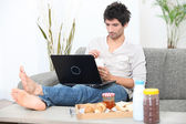 Breakfast with computer — Stock Photo