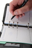 Business writing in a diary — Stock Photo