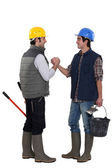 Two construction workers greeting each other — Stock Photo