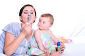 Mother and child blowing bubbles together — Stock Photo