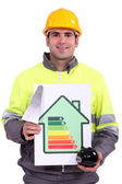 Builder with a plan to save energy — Stock Photo