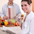 Royalty-Free Stock Photo: Husband cooking for wife