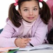 Foto Stock: Young girl doing her homework