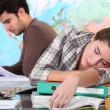 Student sleeping on her desk — Stok fotoğraf