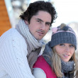 Couple at a ski lodge - Stock Photo