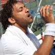 Stock Photo: Tennis player drinking water