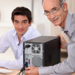 Stock Photo: Happy technicifixing computer
