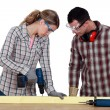 Couple drilling wood — Stock Photo #11050851