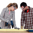 Royalty-Free Stock Photo: Couple drilling wood