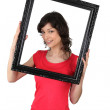 Woman holding a picture frame — Stock Photo #11050872