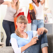 Three women returning from successful shopping trip — Stock Photo