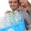 Couple taking out the recycling — Stock Photo #11051044