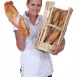 Baker showing off her bread — Stock Photo #11051163