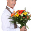 Stock Photo: Older male florist