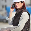 Female site manager using radio to communicate — Stock Photo